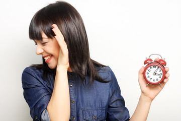 Young woman with alarmclock
