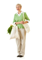 Couple: Standing with Earth Friendly Grocery Bags