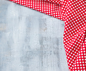 Craquelure background with red textile