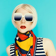 Glamorous blonde in fashionable summer accessory. Scarf with geo