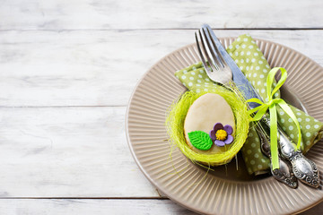 Easter table setting with cookie in shape of egg