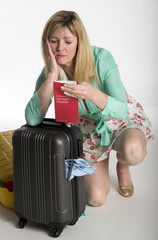 Woman with damaged airline luggage