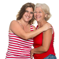 Adult hispanic woman hugging her mother isolated on white