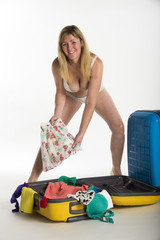Woman in underwear packing a suitcase