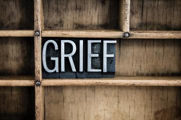 Grief Concept Metal Letterpress Word in Drawer
