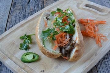 Vietnamese Grilled Pork Banh Mi Sandwich on Rustic Wood Backgrou