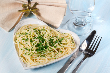 Spaghetti with cheese and fresh parsley