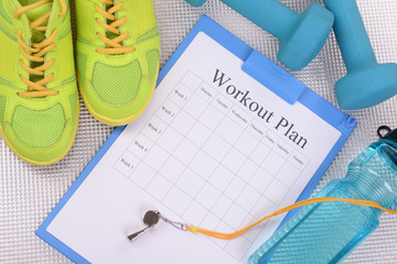 Workout plan and sports equipment top view close-up