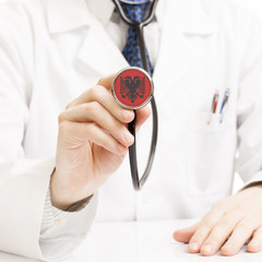 Doctor holding stethoscope with flag series - Albania