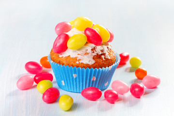 muffins decorated with colored sugar eggs