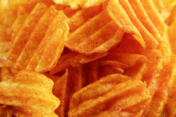 Delicious potato chips closeup background