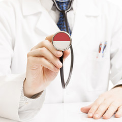 Doctor holding stethoscope with flag series - Indonesia