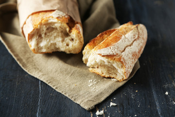 Fresh  baguette on wooden table, close up