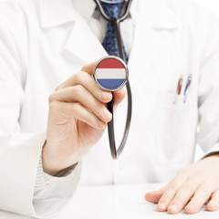 Doctor holding stethoscope with flag series - Netherlands