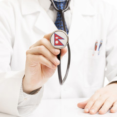 Doctor holding stethoscope with flag series - Nepal