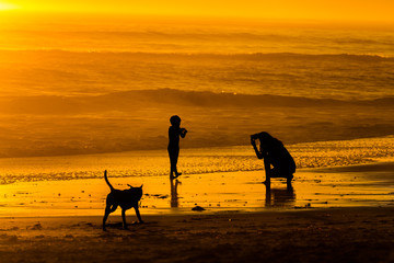 Photographing child at sunset