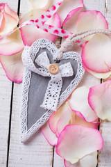 Decorative heart on rose petals