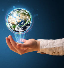 Woman holding a glowing earth globe