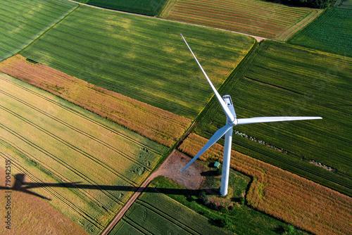 Wind turbine on a field, aerial photo - 79042515
