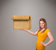 Young woman holding an empty cardboard box