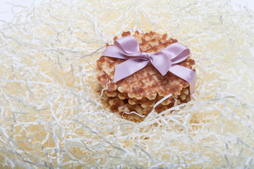 waffles tied with a ribbon lying in straw