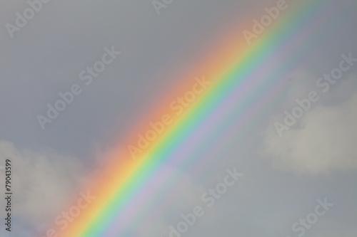 Papiers peints Colline Rainbow in the cloudy sky