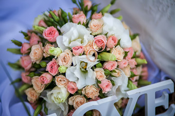 wedding rings on the bridal bouquet