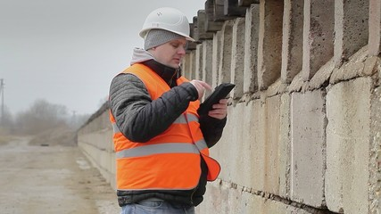 Engineer near the concrete walls