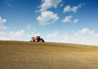 Tractor plowing field in early spring.