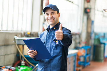 Smiling mechanic thumbs up