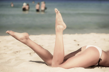 Woman is lying on the beach