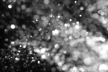 Snowstorm texture. Defocused snowflakes or rain drops in he air