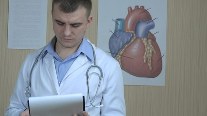 physician reviews the paper,  close-up