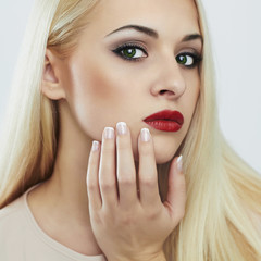 Blond woman with manicure.Beautiful girl.make-up and nails