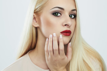Blond woman with manicure.Beautiful girl with evening make-up