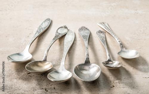 Leinwandbild Motiv various empty silver spoons