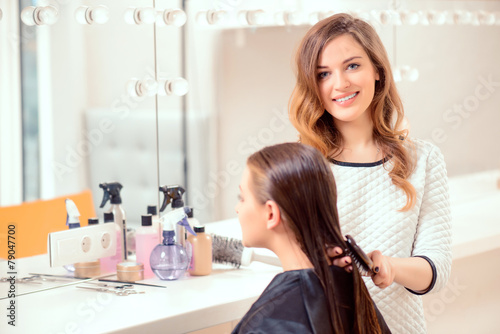 Beautiful woman in hair salon - 79047700