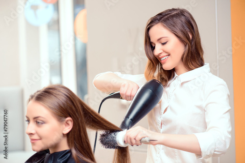 Beautiful woman in hair salon - 79047760