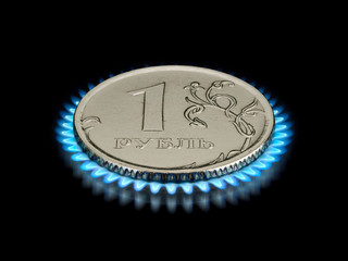 Coin advantage in one ruble on a gas flame