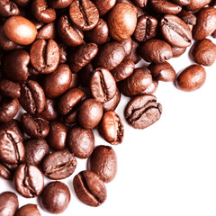 Brown coffee beans  Isolated On White Background. Roasted coffee