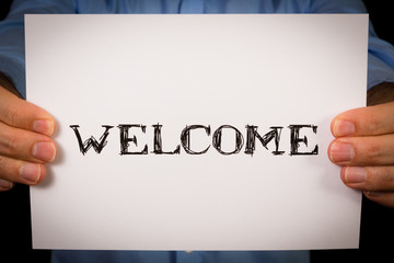 Man with Welcome sign