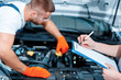 Car mechanics at the service station - 79050735
