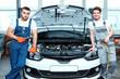 Car mechanics at the service station - 79050766