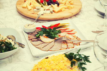 Covered table  - a plate of cold cuts, cheese plate