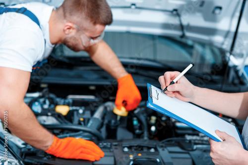 Car mechanics at the service station - 79050735
