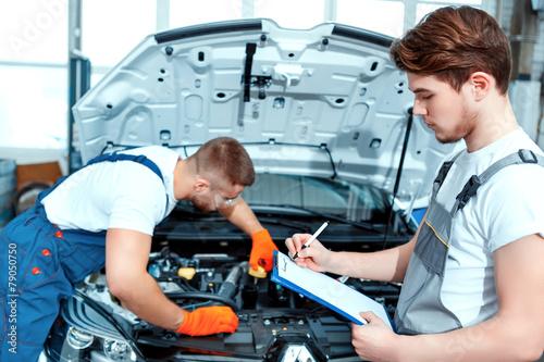Car mechanics at the service station - 79050750