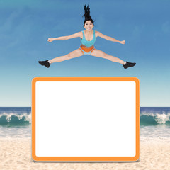 Healthy woman jumping over copyspace