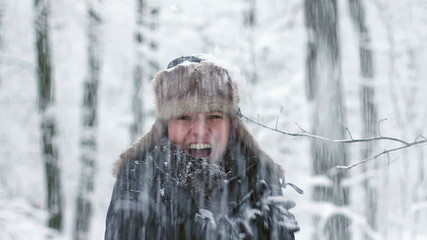 Young woman in winter clothes trying to warm up, slow motion