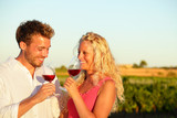 Drinking red wine couple at vineyard