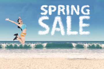 Healthy woman with spring sale clouds